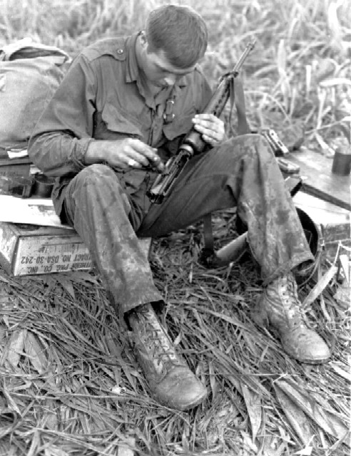 RVN, KONTUM PFC John Henson (Columbia, SC) of the 1st Battalion, 327th Infantry, 101st Airborne Division, cleans his M-16 rifle while on an operation 30 miles west of Kontum. 12 July 1966