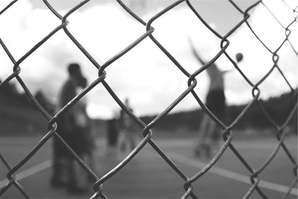 image - chainlink fence around basketball game