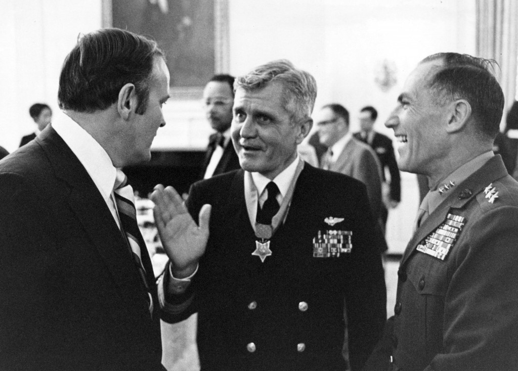 Washington, D.C. (March 4, 1976) – Medal of Honor recipient Rear Adm. James B. Stockdale, center, chats with guests including Assistant Commandant of the U. S. Marine Corps, Lt. General Samuel J. Jaskilka, right, following his award ceremony in the East Room of the White House. U.S. Navy photo by Dave Wilson (RELEASED)